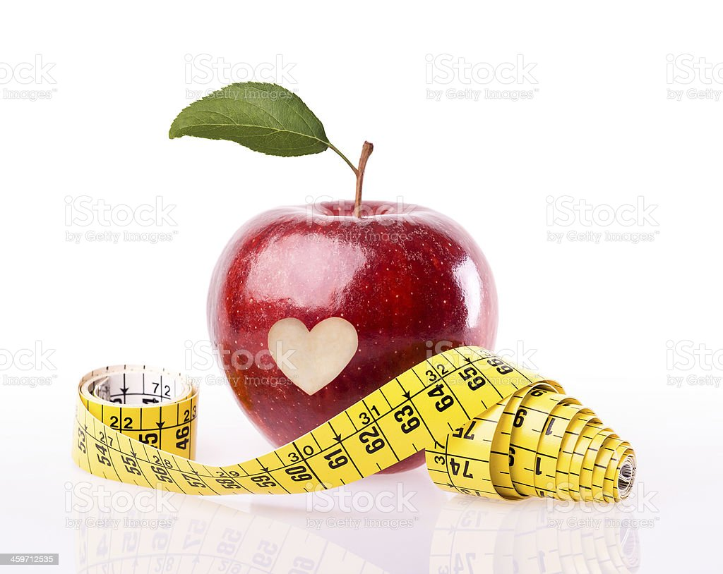 Heart health concept apple with measuring tape stock photo
