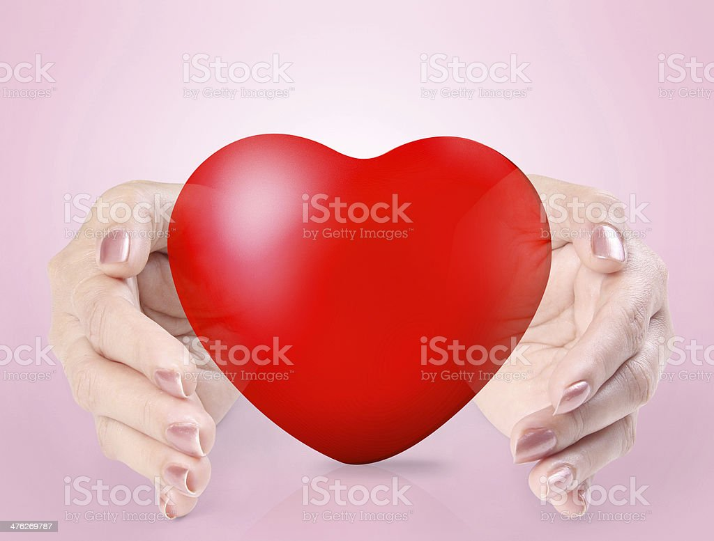 Heart in a hands isolated royalty-free stock photo