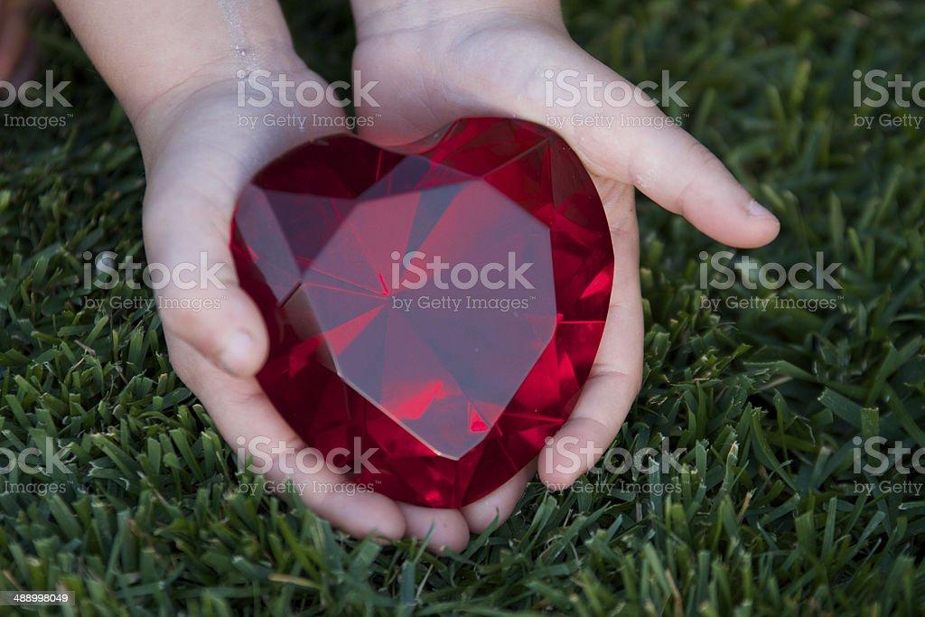 Heart in child's hand stock photo