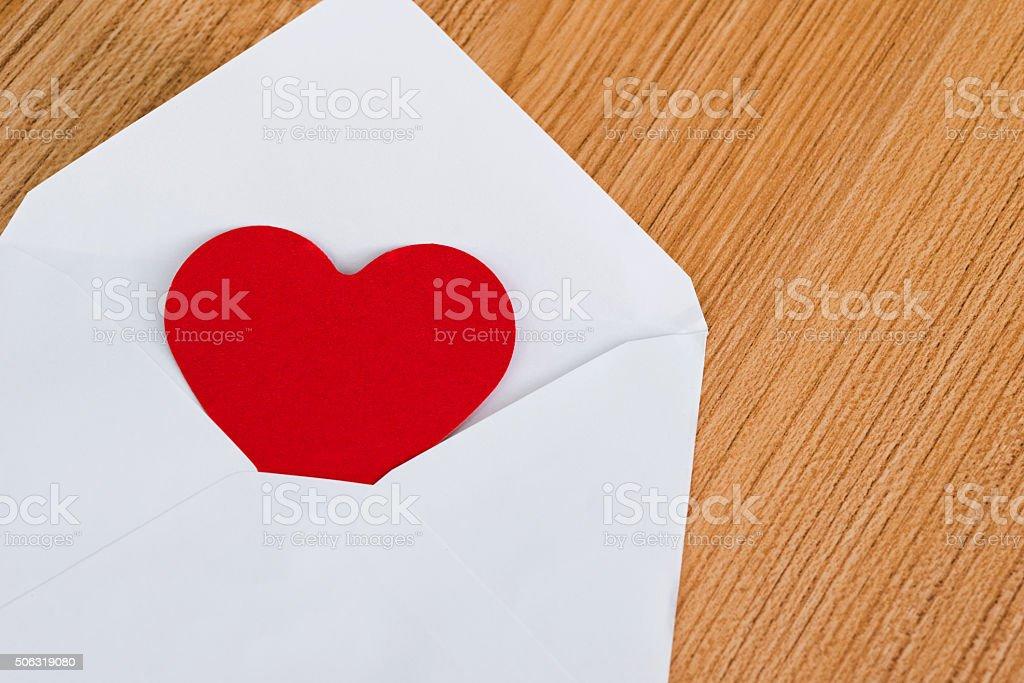 Heart in envelope stock photo