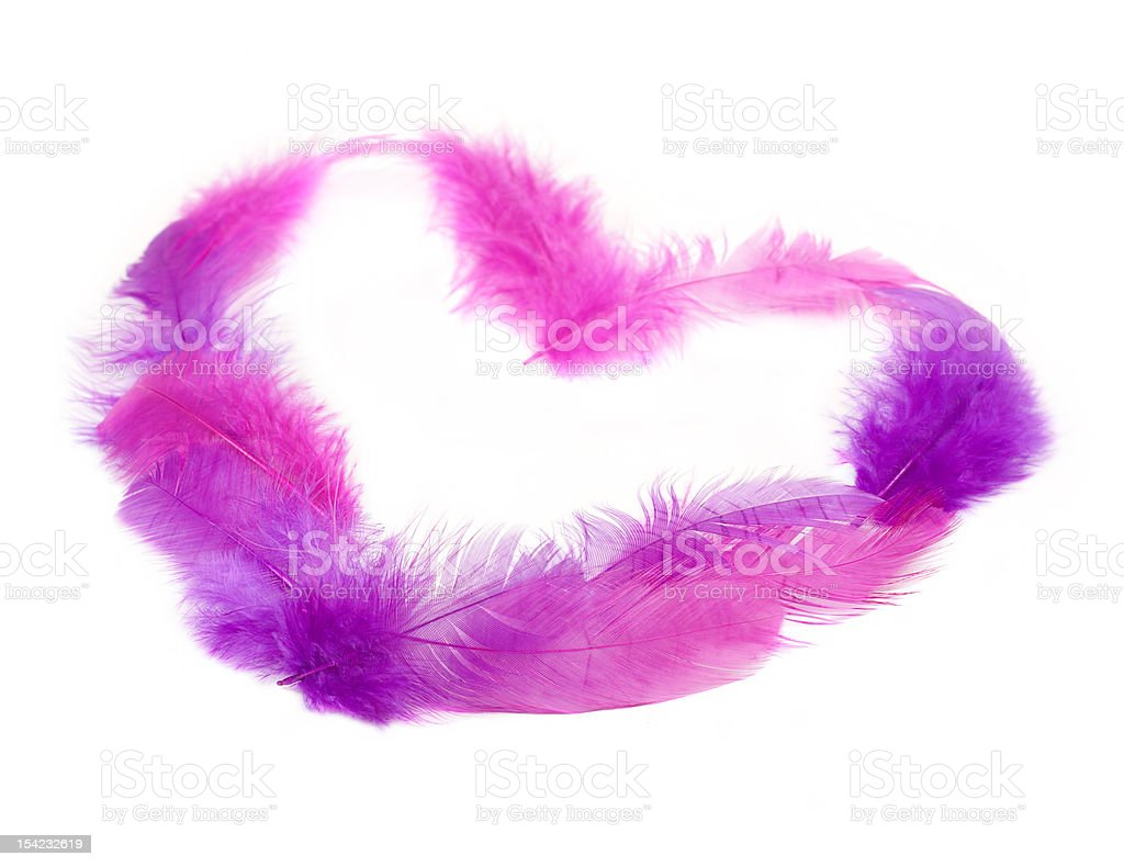 Heart in pink feathers. Soft focus. stock photo