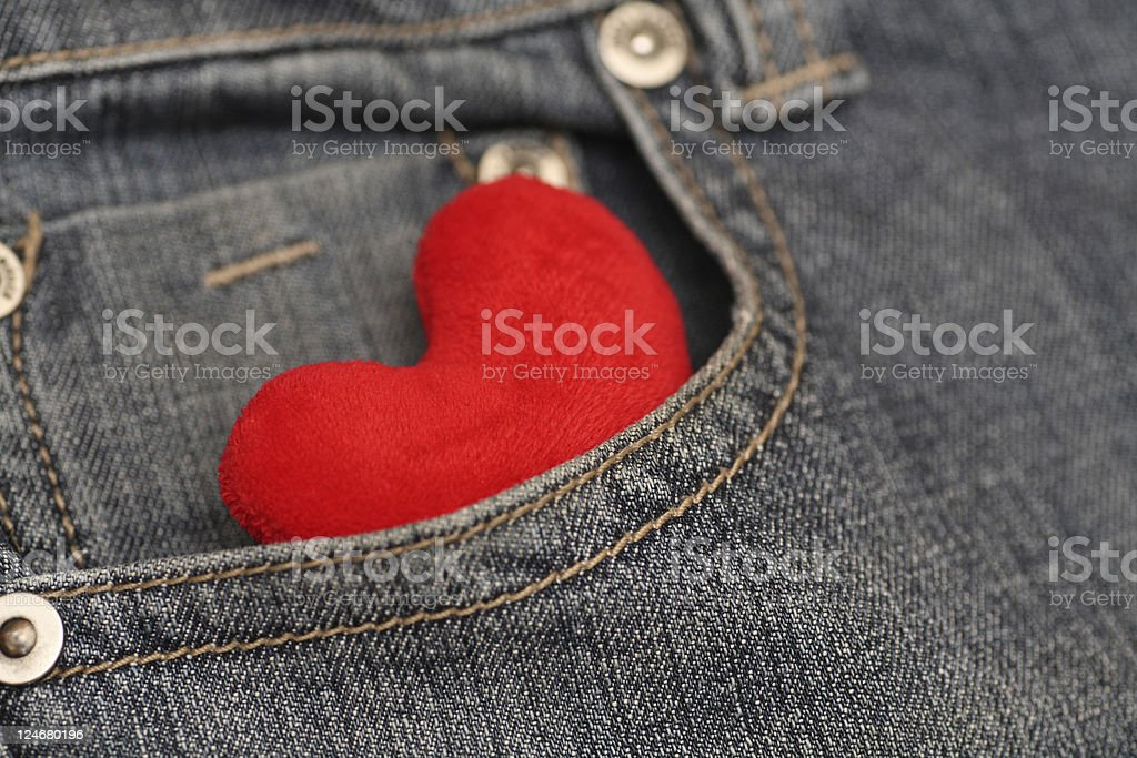 Heart in pocket of jeans stock photo