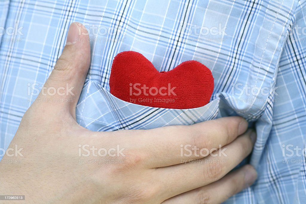 Heart in pocket of shirt stock photo