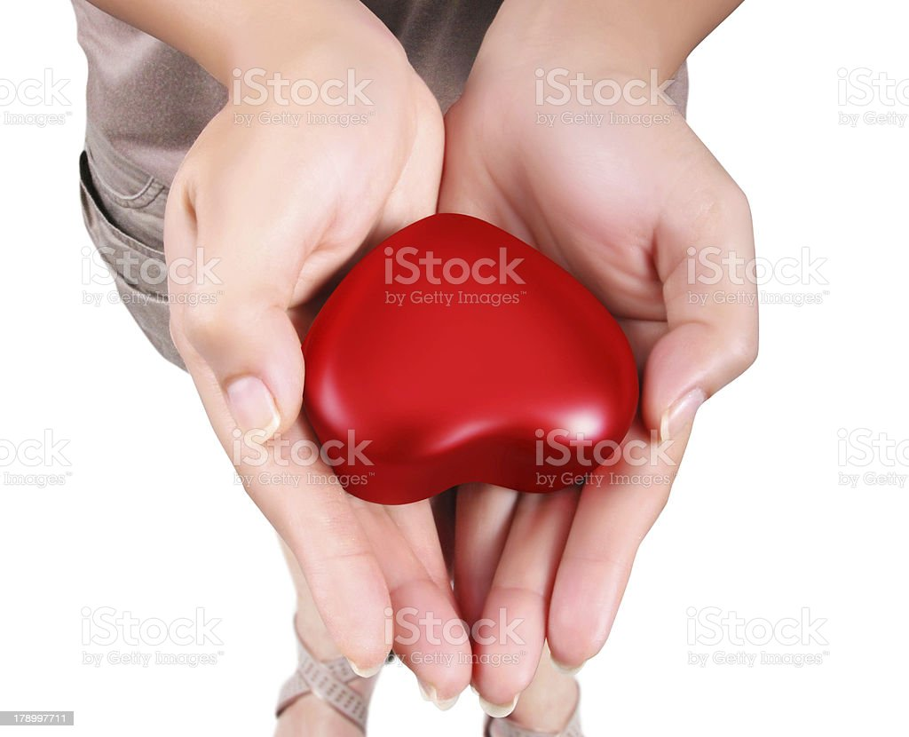 Heart in the hands isolated royalty-free stock photo