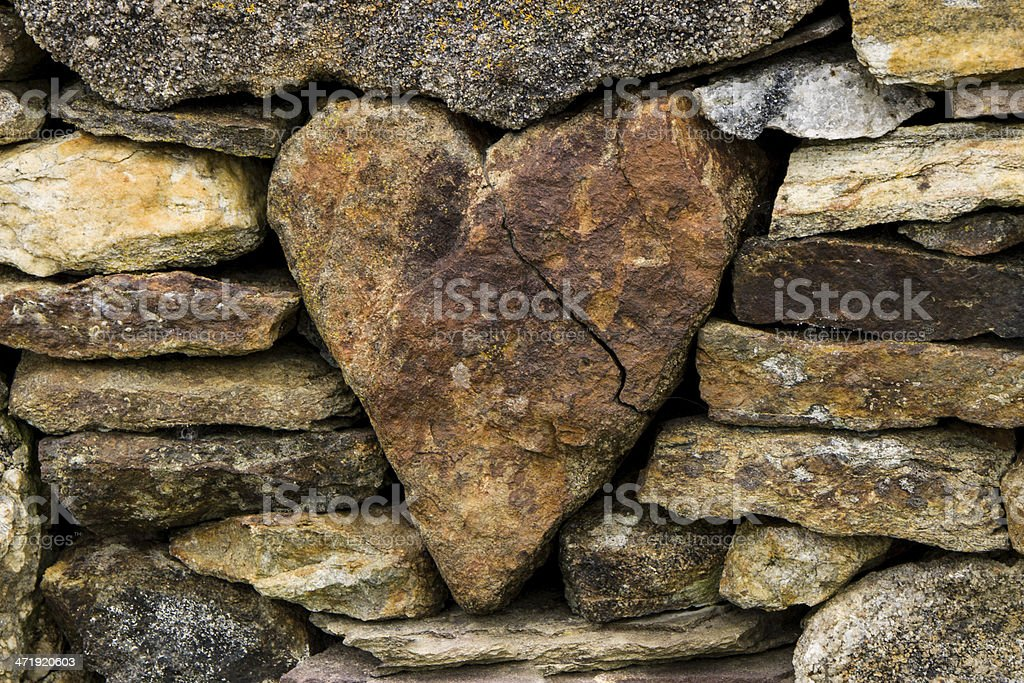 Heart in the stone fence stock photo