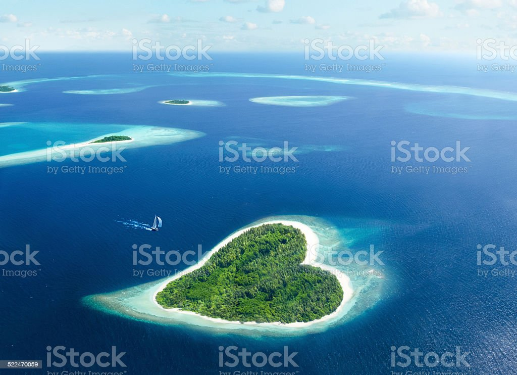 heart island in the maldivian tropical sea stock photo