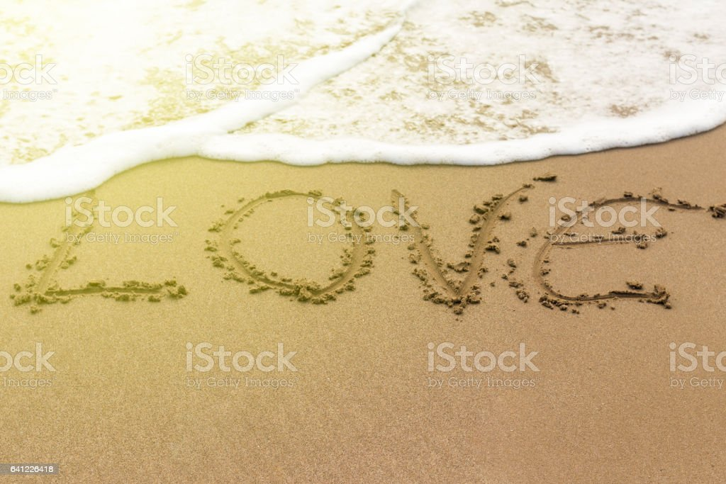 Heart love drawn on sand stock photo