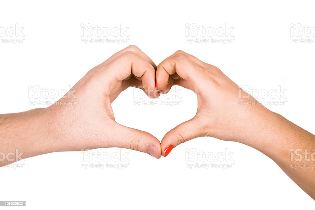 Heart made by two hands in love stock photo