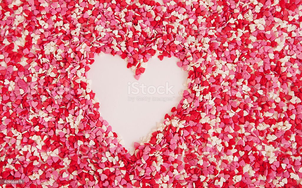 Heart made from colored sprinkles stock photo
