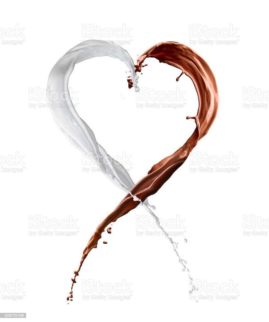 heart made of chocolate and milk splash stock photo