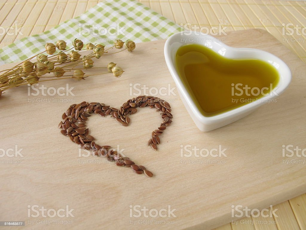 Heart made of linseed and flaxseed oil stock photo