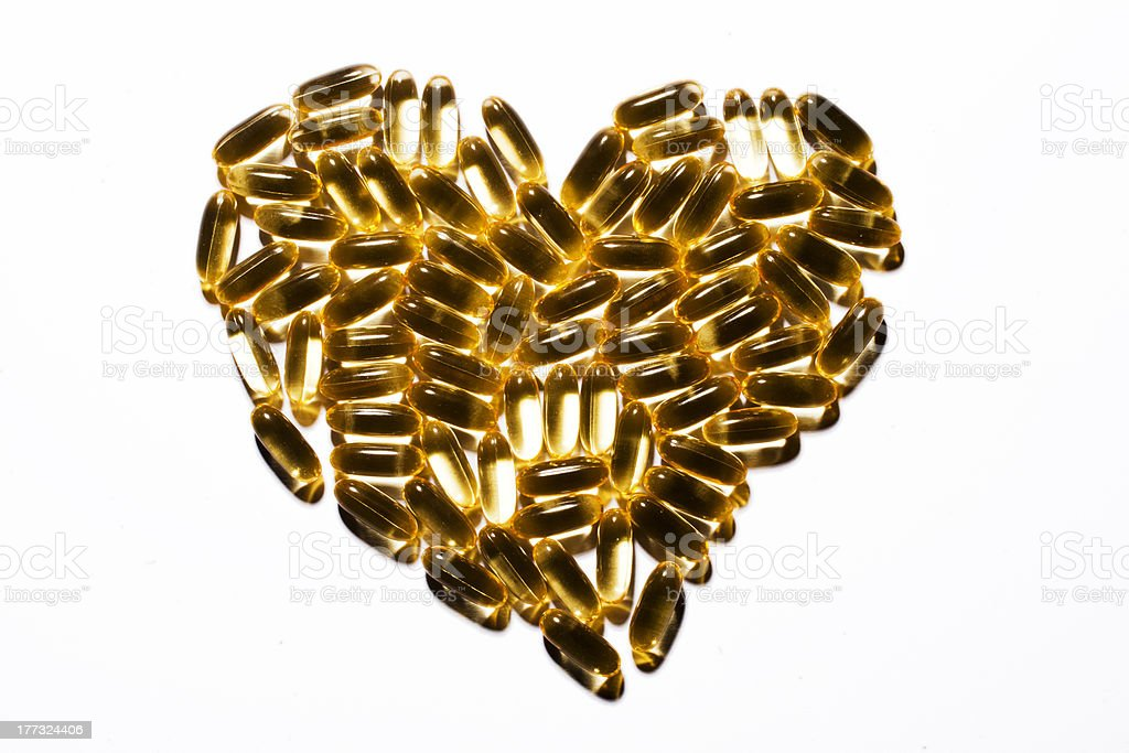 heart made of omega-3 capsules royalty-free stock photo