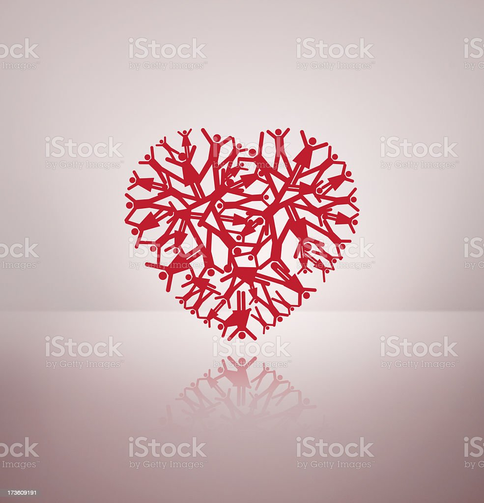 Heart made of silhouettes of people with arms in the air stock photo