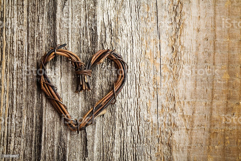 Heart made of twisted vines set on bark royalty-free stock photo