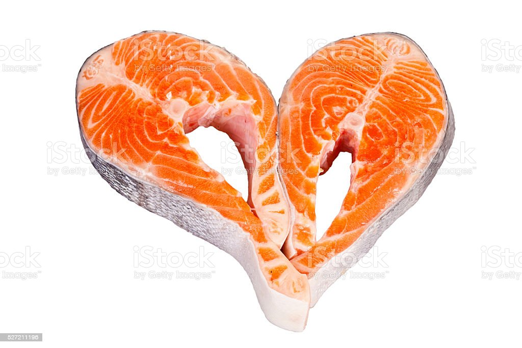 heart made of two raw salmon steaks stock photo