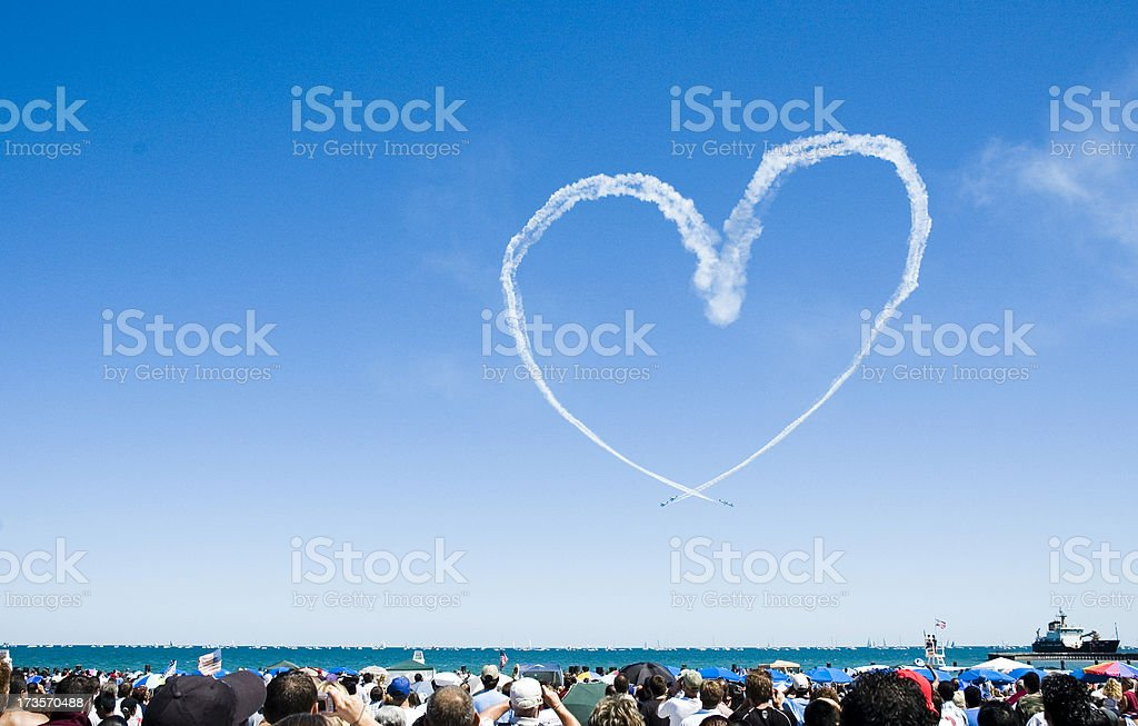 Heart made out of a planes smoke trail royalty-free stock photo