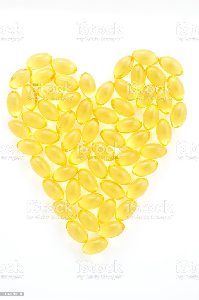 Heart made out of fish oil supplements stock photo