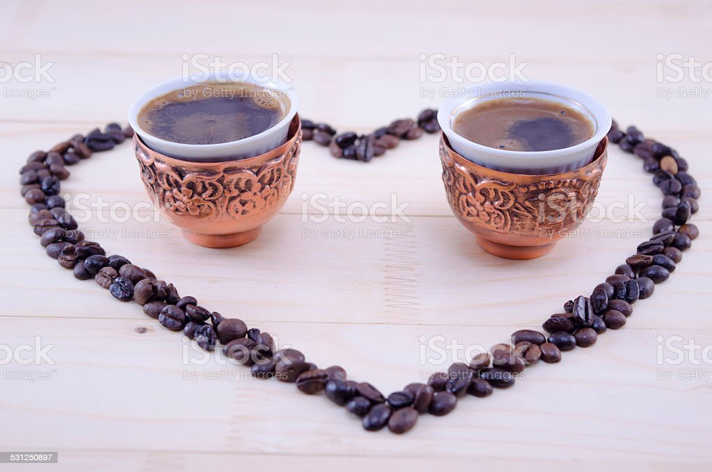 Heart made out of raw grains of coffee royalty-free stock photo