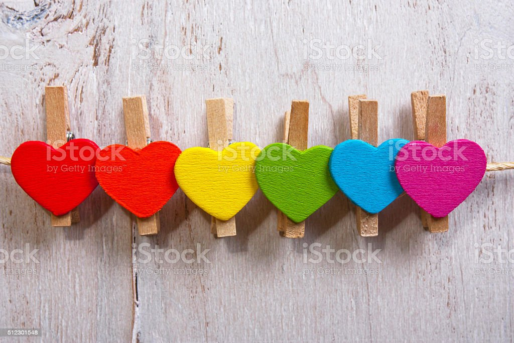 heart multicolored on a white wooden background.LGBT symbol stock photo