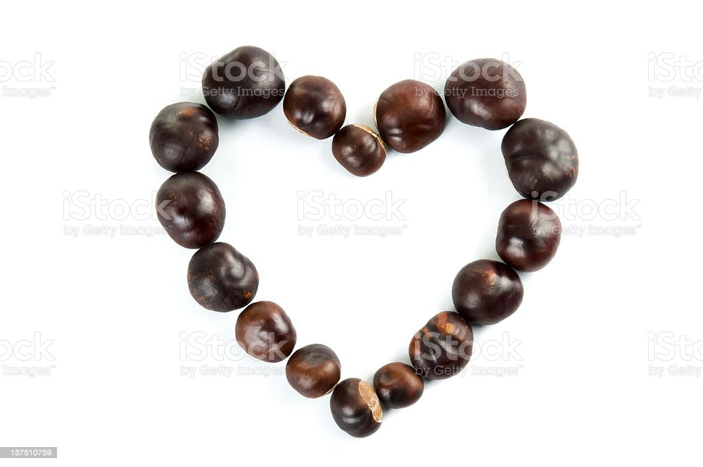 Heart of chestnuts on white. royalty-free stock photo