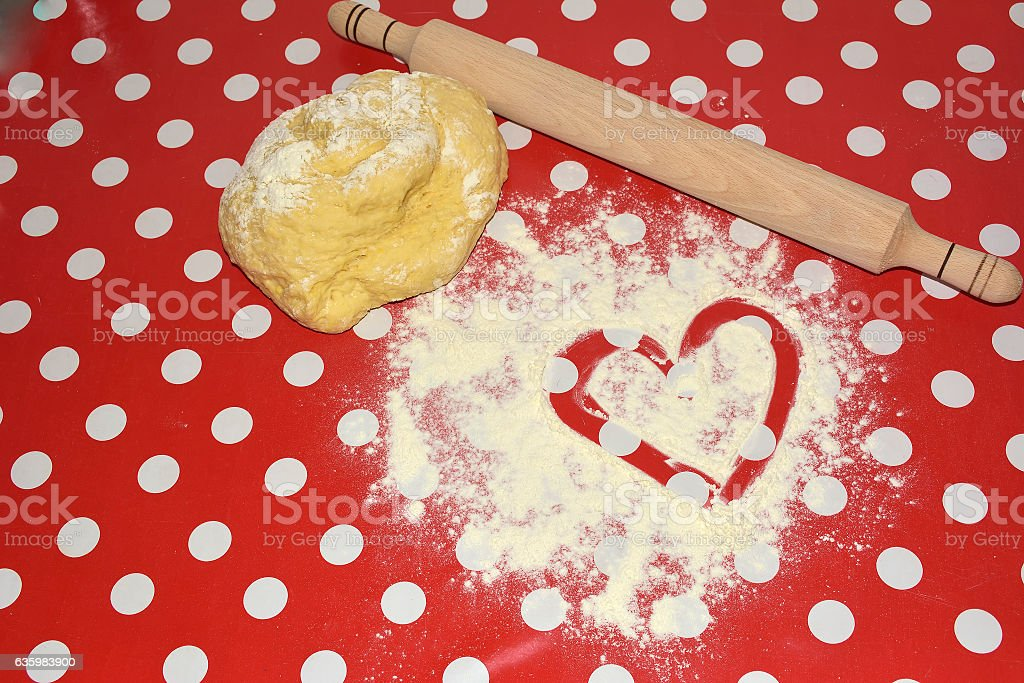 Heart of flour and rolling pin stock photo