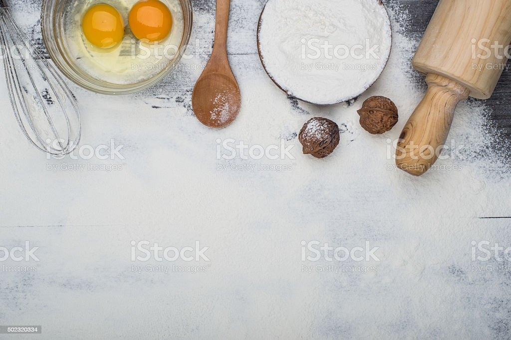 heart of flour on wooden desk stock photo