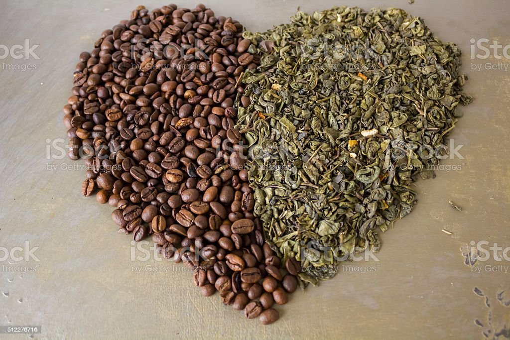 Heart of grains  black coffee and green tea leaves stock photo