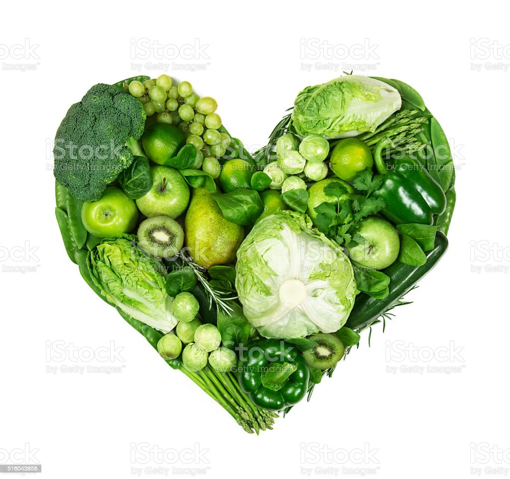 Heart of green fruits and vegetables stock photo