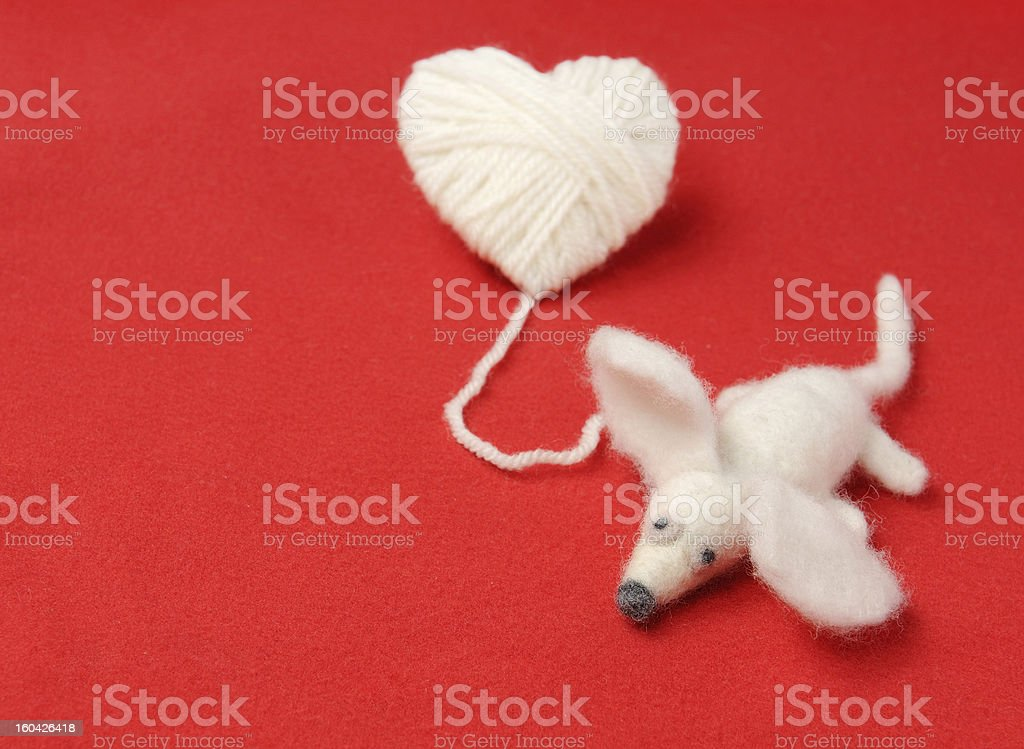 Heart of knitting with cute felt mouse royalty-free stock photo