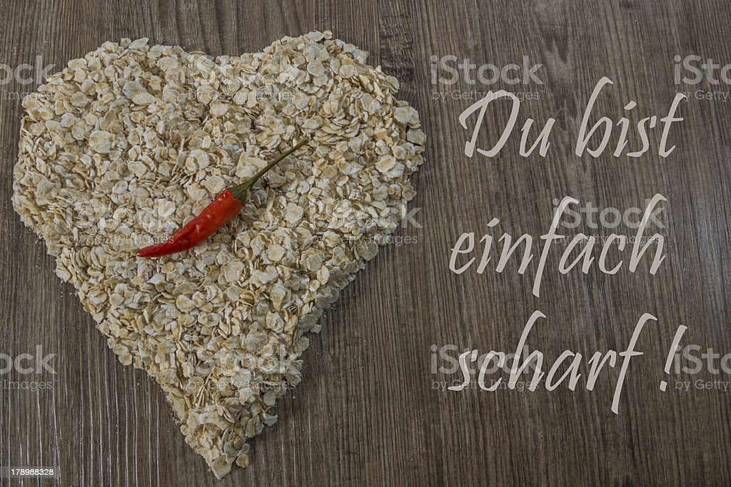 Heart of oat flakes with a German text royalty-free stock photo
