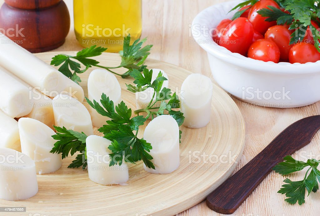 Heart of palm (palmito) with cherry tomato, olive oil stock photo