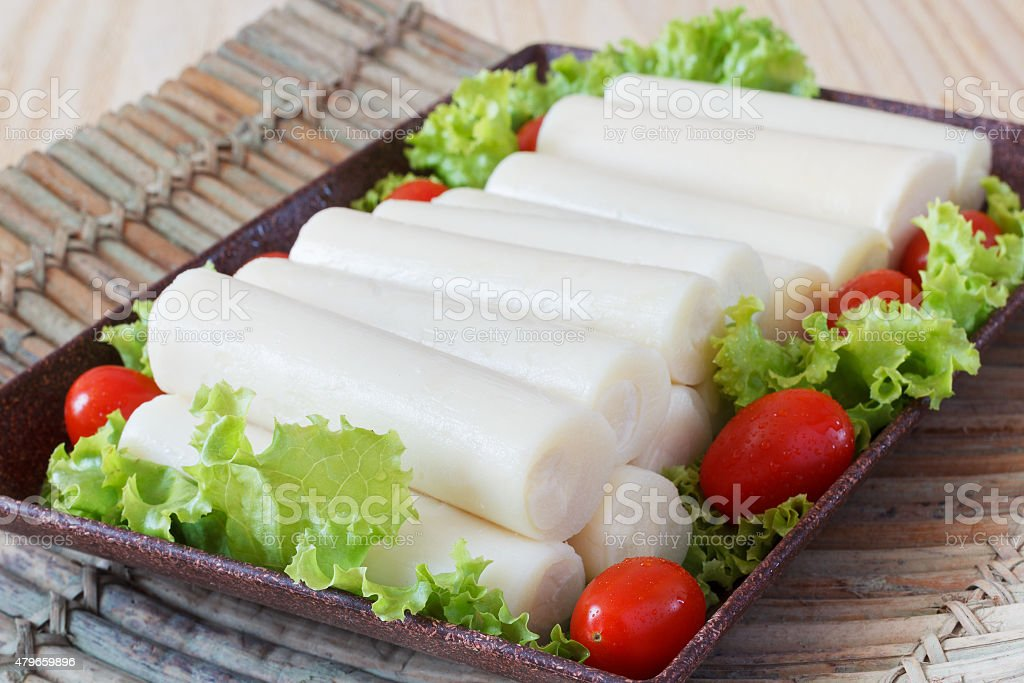 Heart of palm (palmito) with cherry tomato on plate stock photo