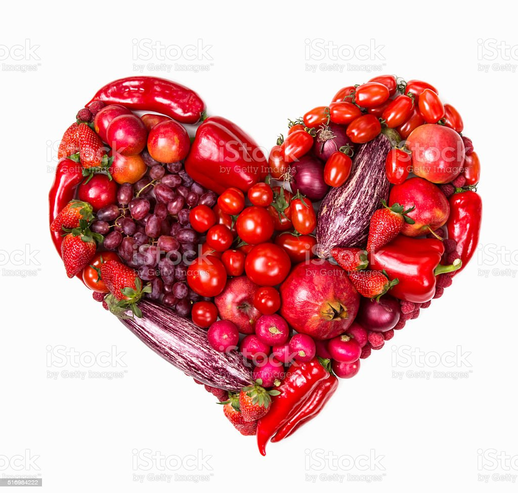 Heart of red fruits and vegetables stock photo
