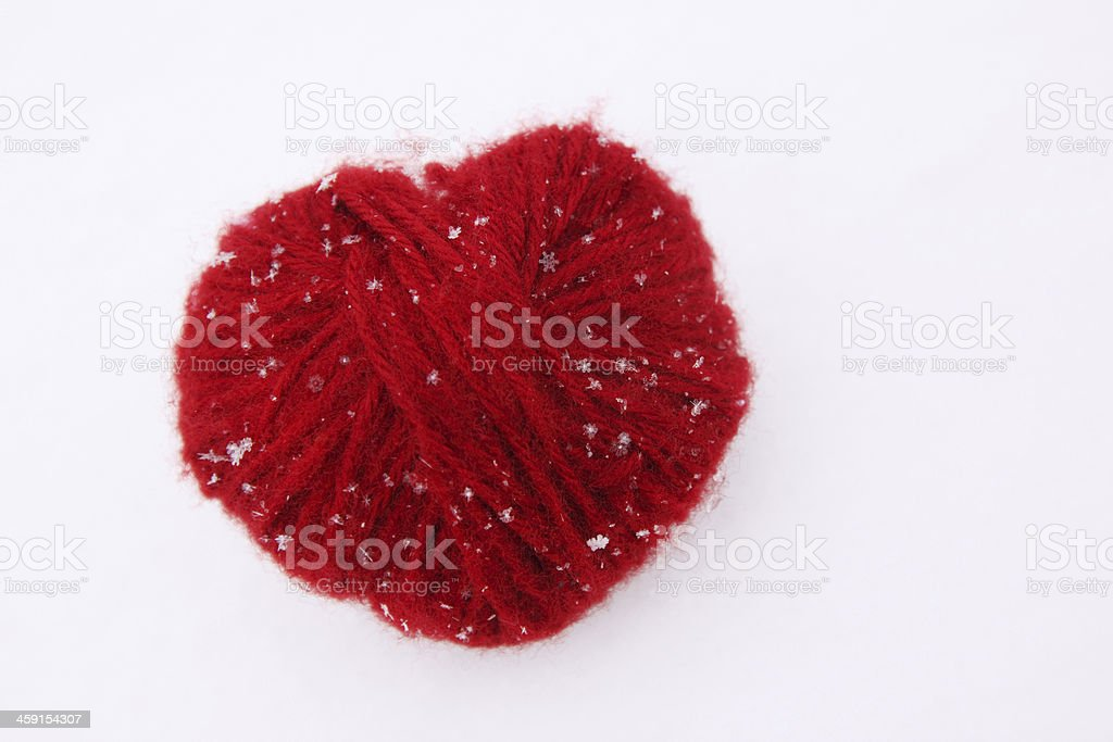 heart of red woolen threads stock photo