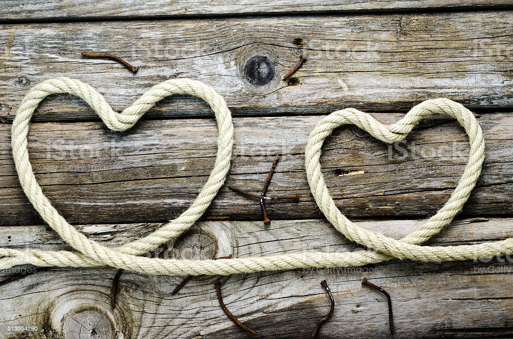 heart of rope on the old board stock photo