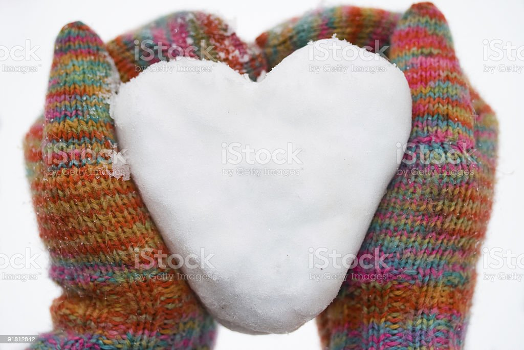 heart of snow in gloves royalty-free stock photo