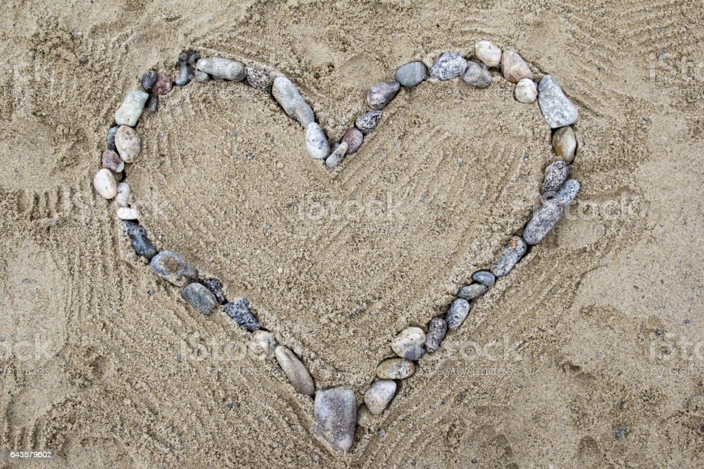 Heart of stones on the beach 2 stock photo