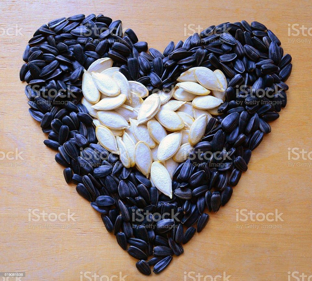 Heart of sunflower seeds and pumpkin stock photo