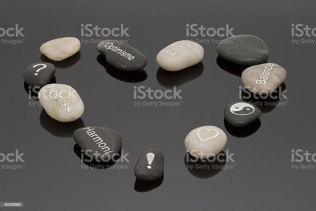 Heart of wellness stones stock photo