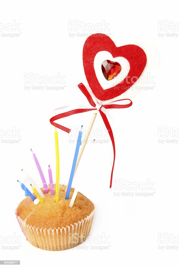 Heart on a stick and celebratory fruitcake with candles royalty-free stock photo