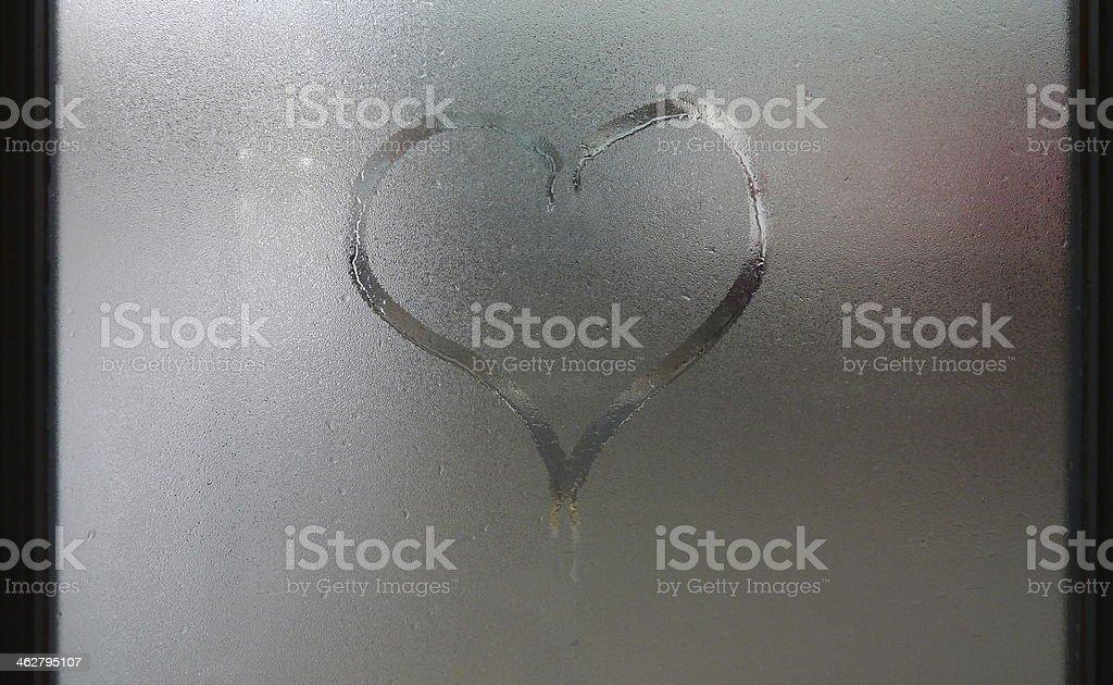 heart on foggy window stock photo