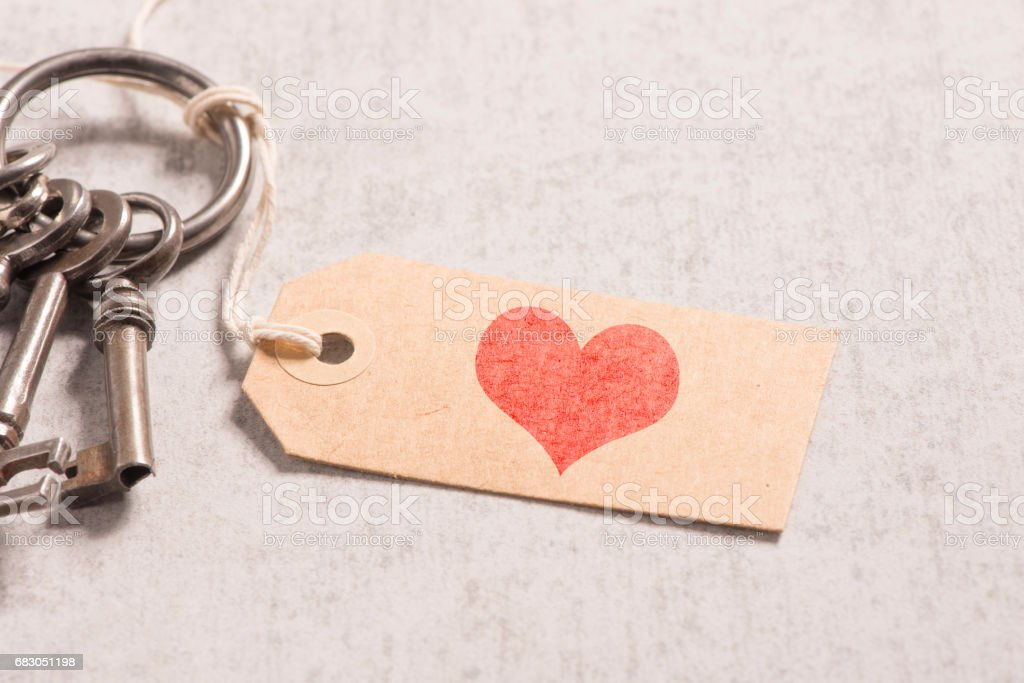 Heart on paper tag and vintage key set stock photo