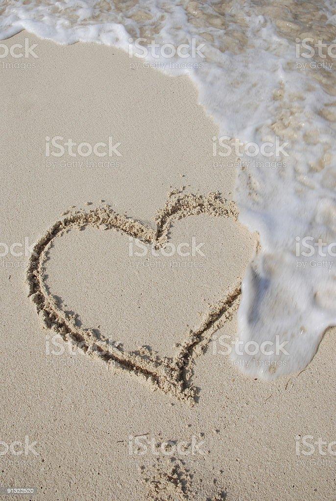 Heart on sand beach royalty-free stock photo