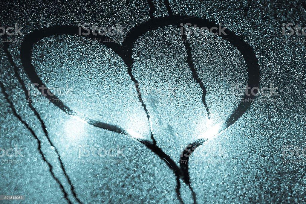 heart on wet window stock photo