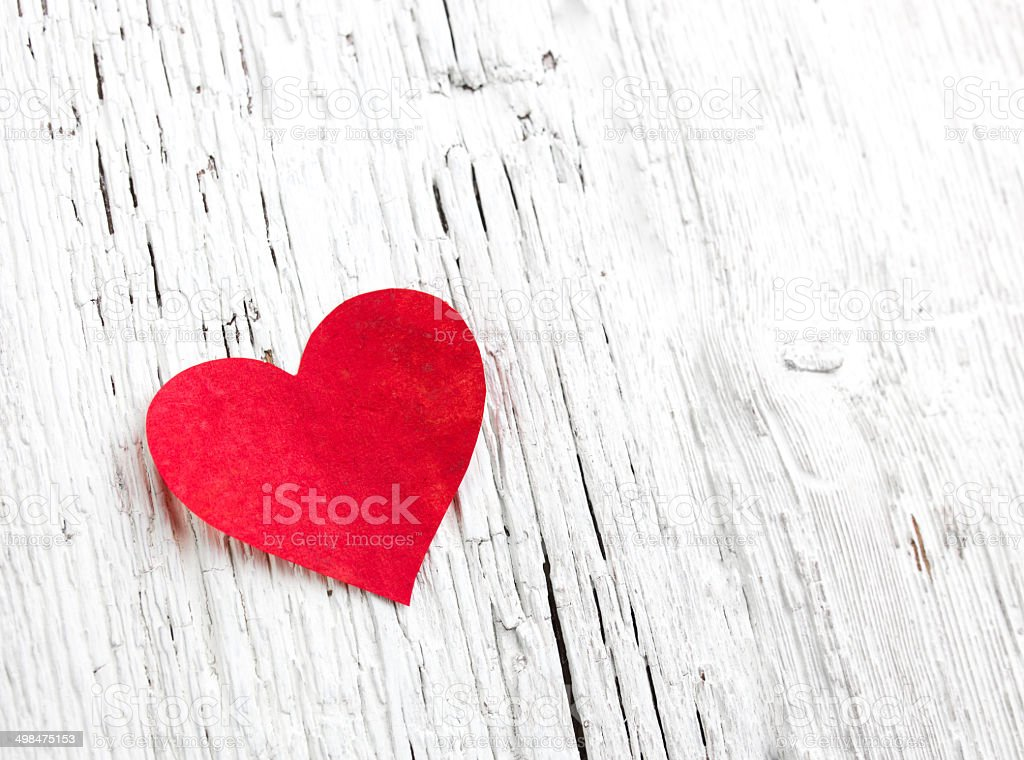 Heart on white wood background stock photo