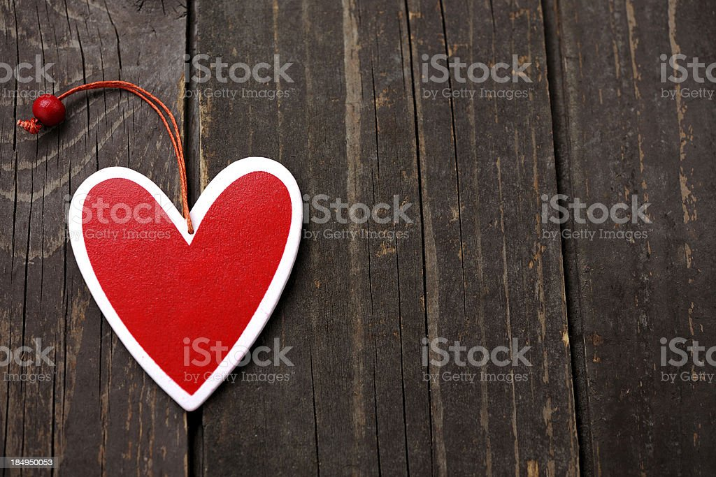 Heart on wooden background royalty-free stock photo