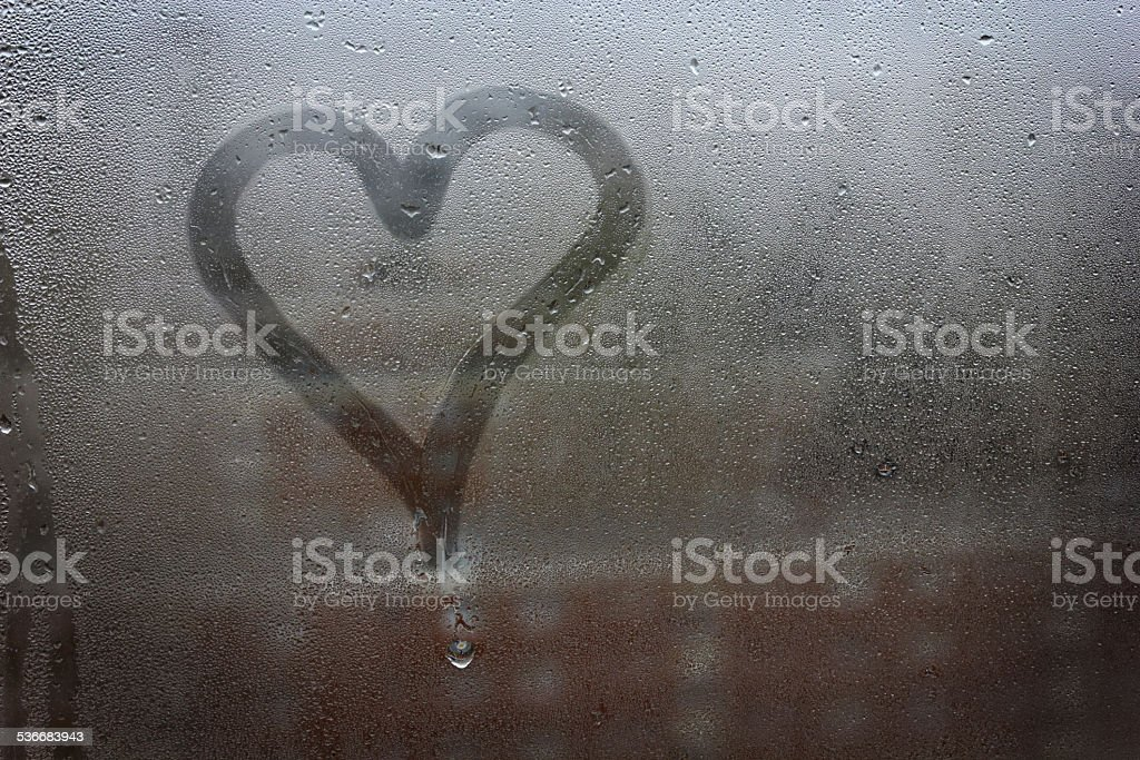 Heart painted on glass stock photo
