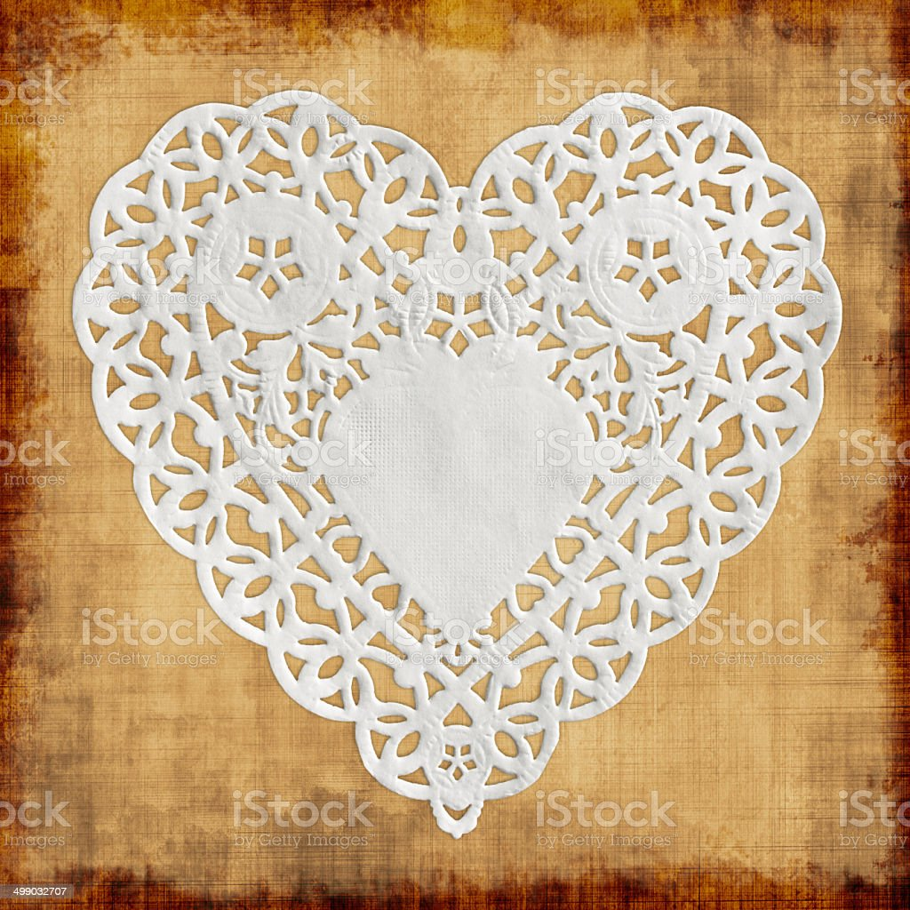 Heart paper on beige background stock photo