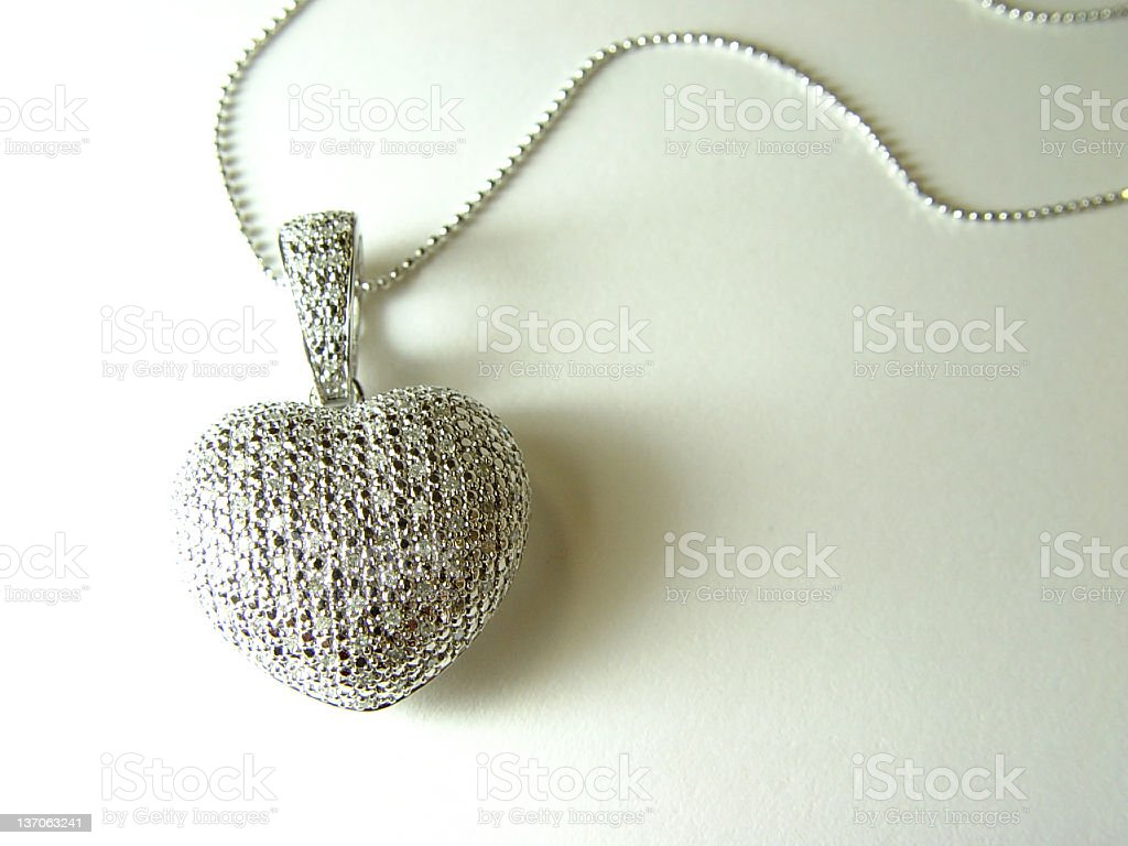 Heart pendant with diamond scales royalty-free stock photo