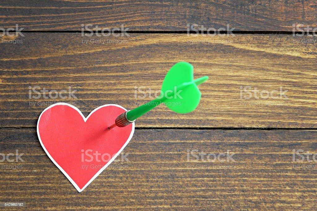 Heart pierced by an arrow stock photo